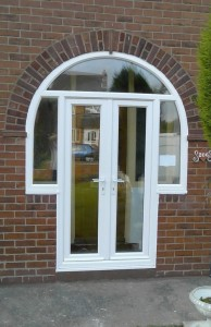 1230653383arched french doors